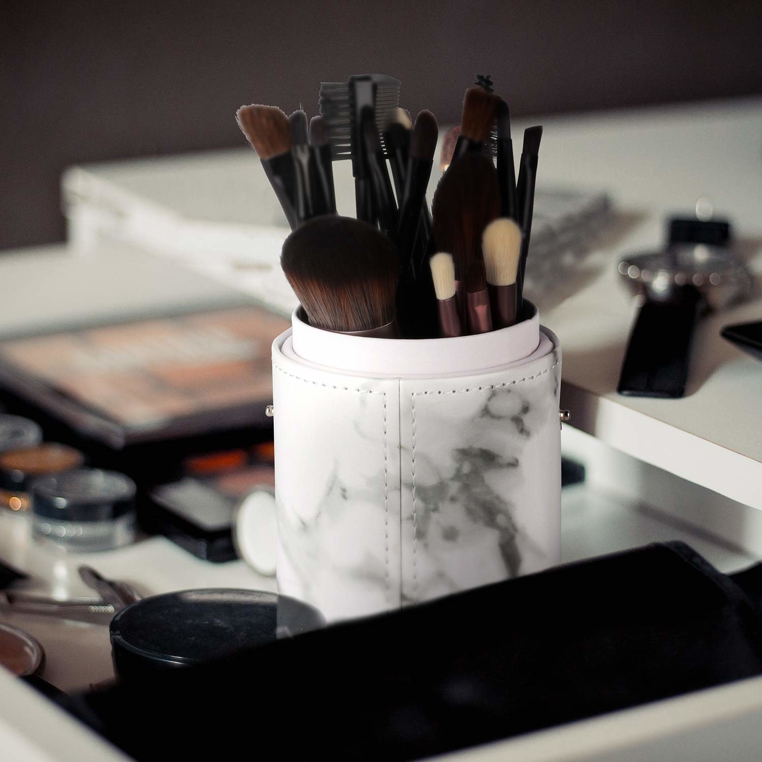 makeup countertop with the cylinder shape brush container in a white and gray marble print