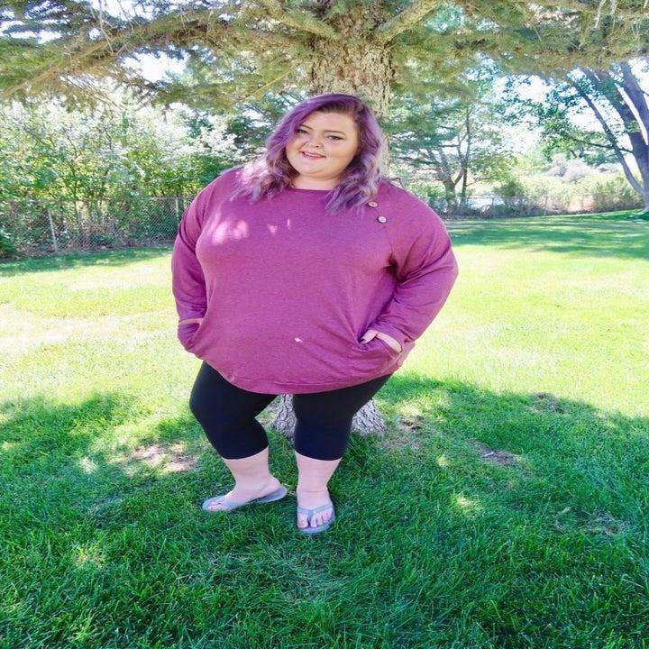 reviewer wearing top in purple pink