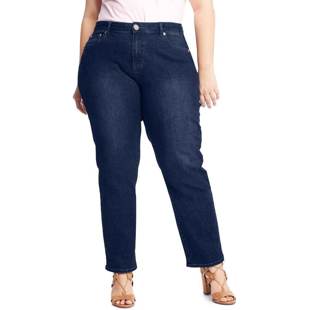 model wears dark wash skinny jeans
