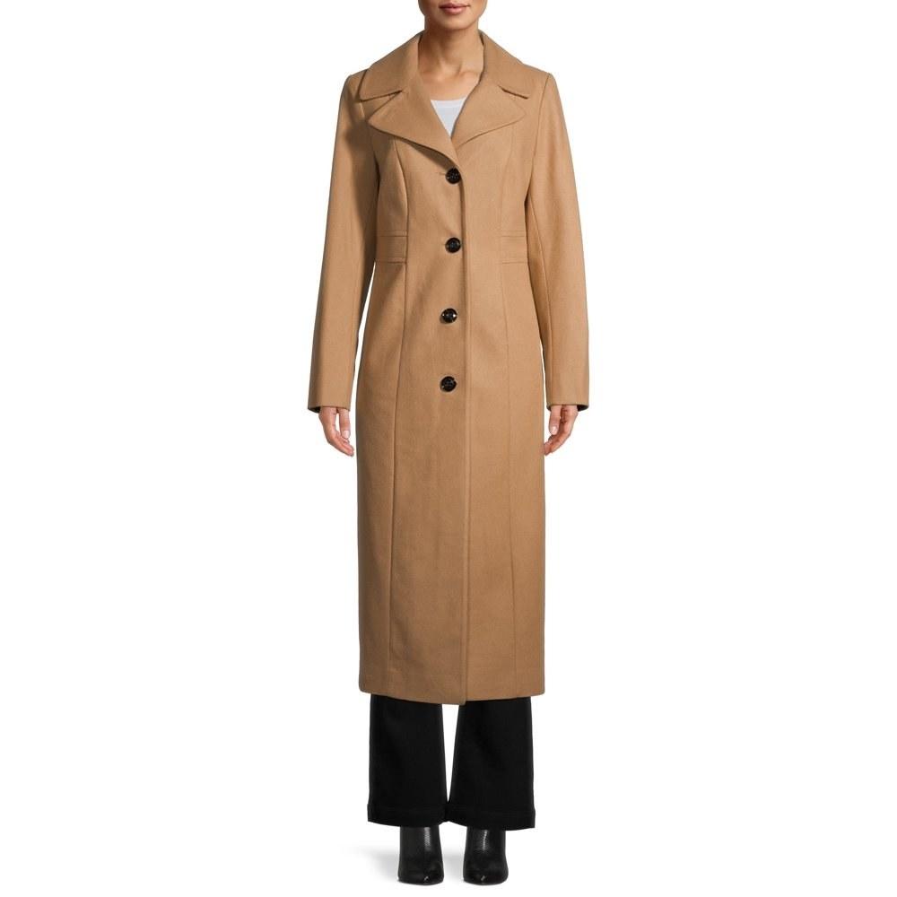 model wears camel trench style coat