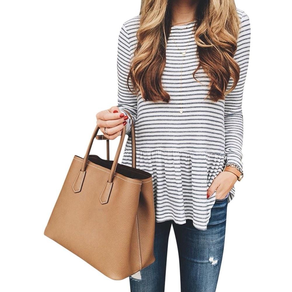 model wears striped long sleeve peplum top
