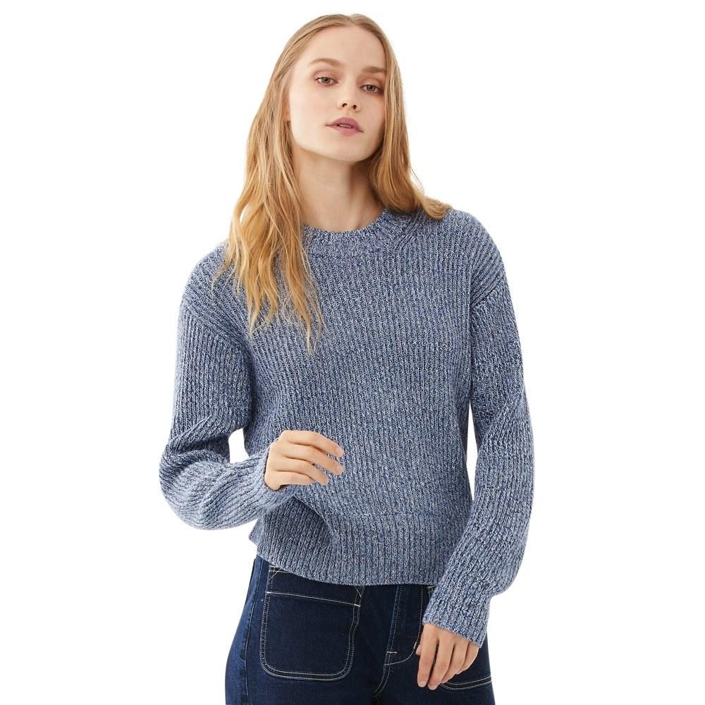 model wears thick knit blue sweater