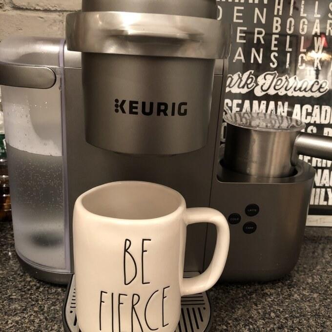 The silver Keurig coffee maker