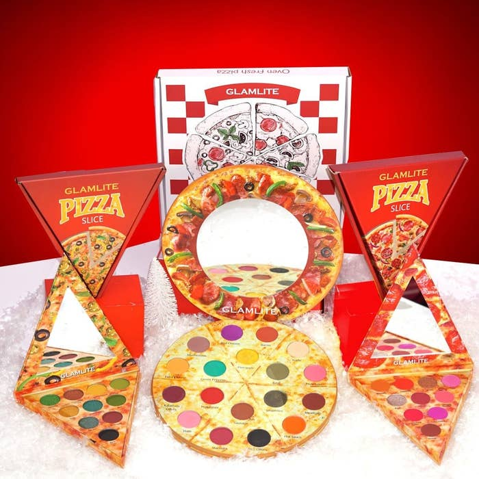 An eyeshadow palette that looks like a whole pizza and two smaller palettes that look like slices of pizza