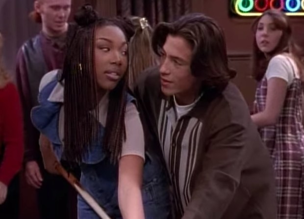 Brandy and Andrew Keegan play pool in a still from Moesha