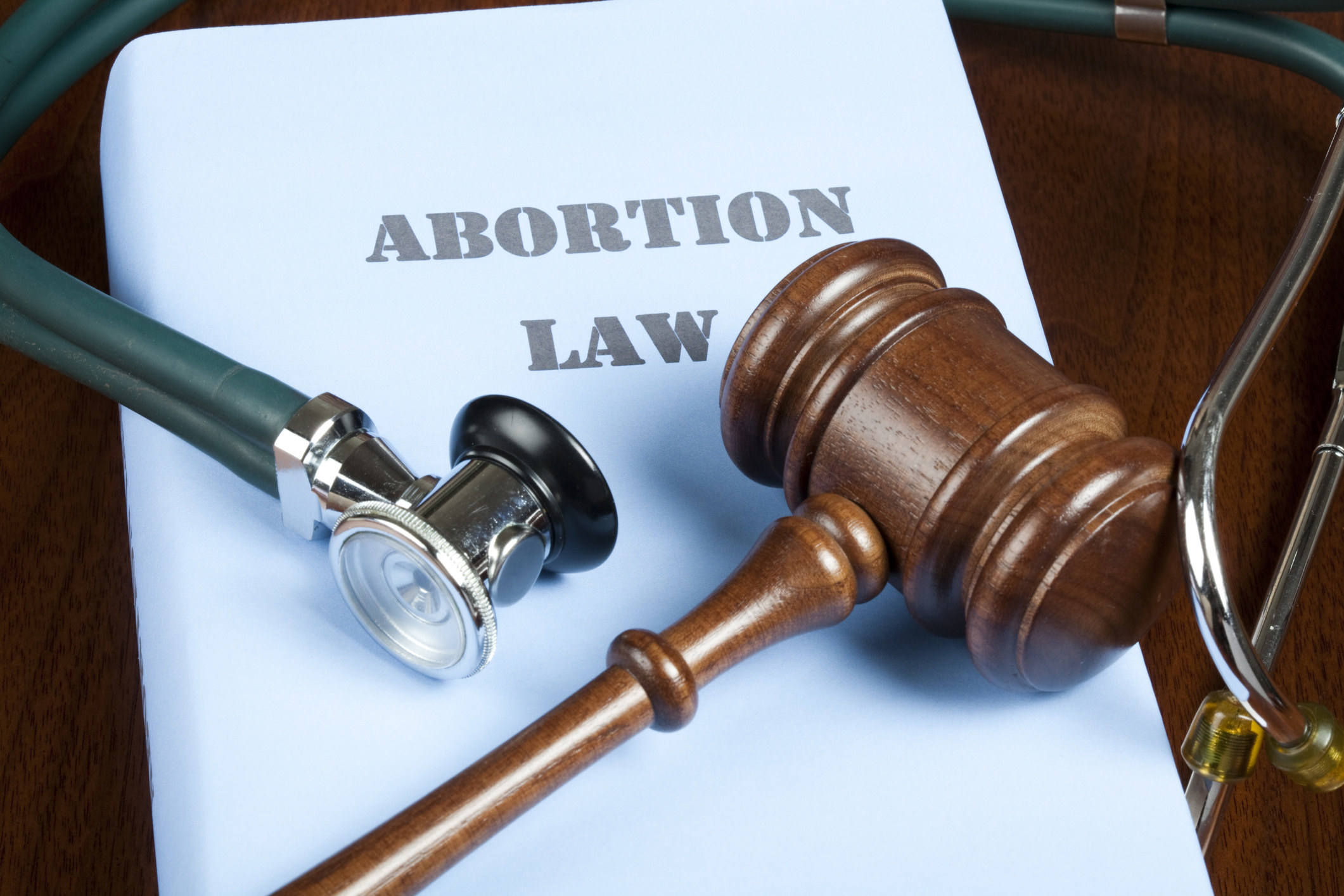 Text of abortion law with gavel and stethoscope.