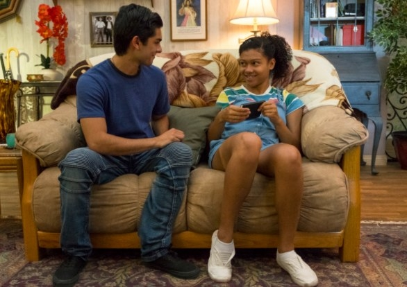 Diego Tinoco and Sierra Capri sit on a couch in On My Block