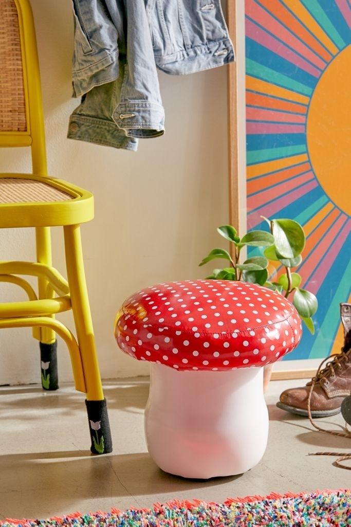 the toadstool with a white base and red and white polka dot mushroom head as the seat