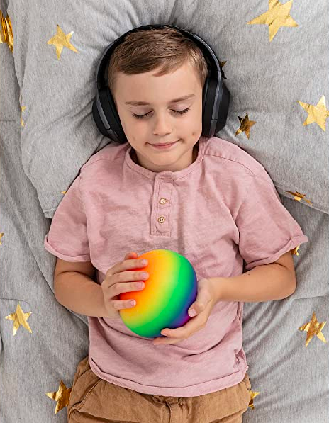 a child holding the large rainbow stress ball