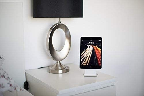 a device being held up by the stand on an end table