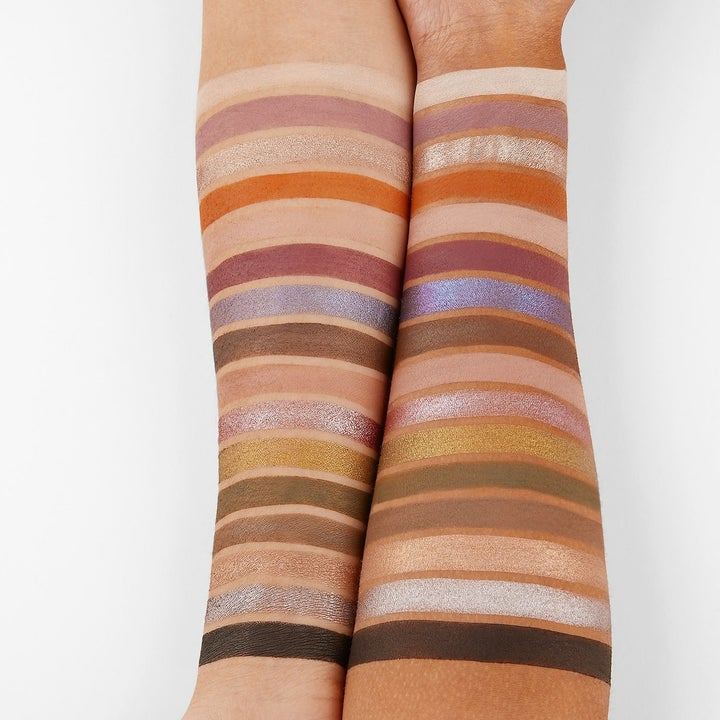 the palette's shades swatched on the forearms of a light-skin model and a dark-skin model