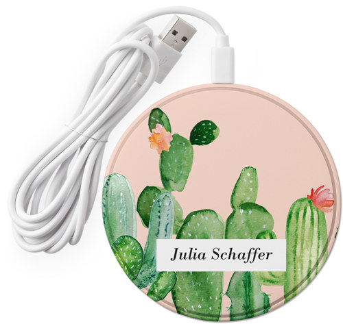 The pink wireless charger with illustrated cactuses and a name