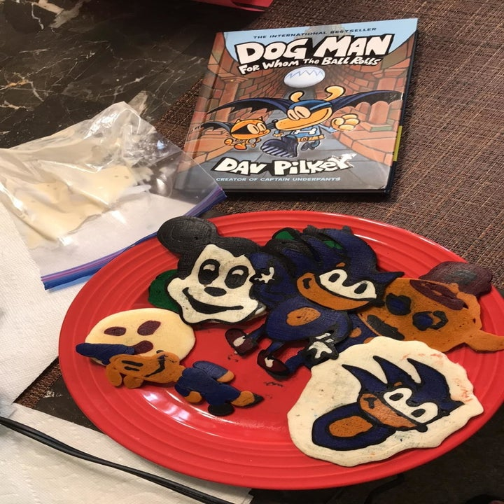 colorful pancakes characters shaped like sonic, mickey, and dog man