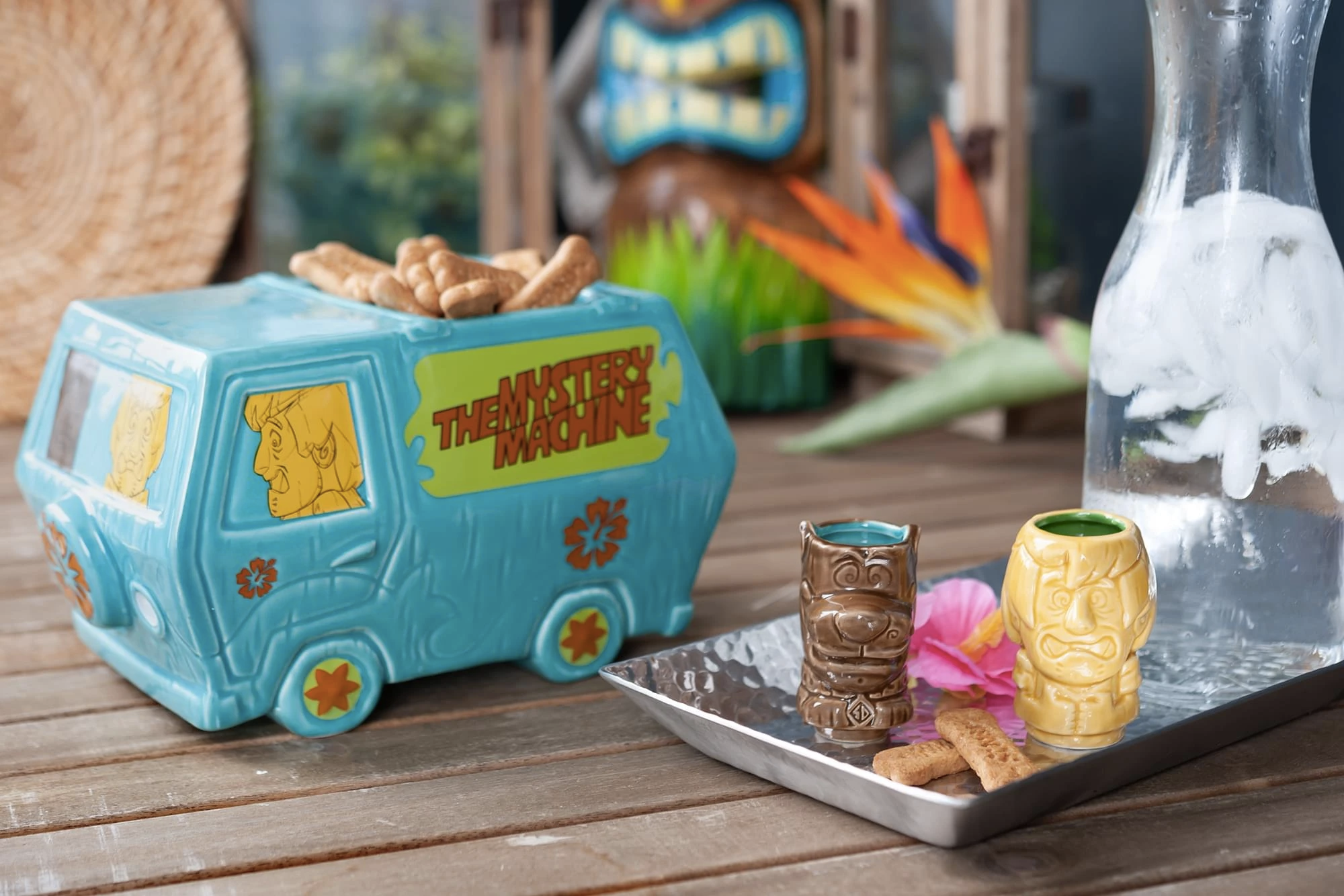 van-shaped punch bowl with small tiki mugs shaped like scooby and shaggy