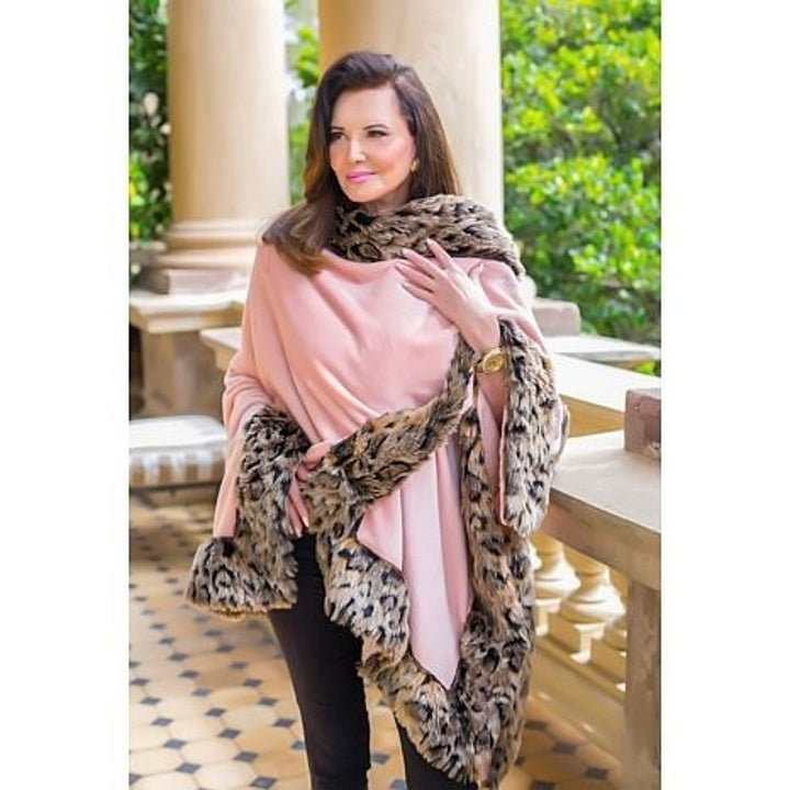 Patricia Altschul in a pink wrap with faux fur trim