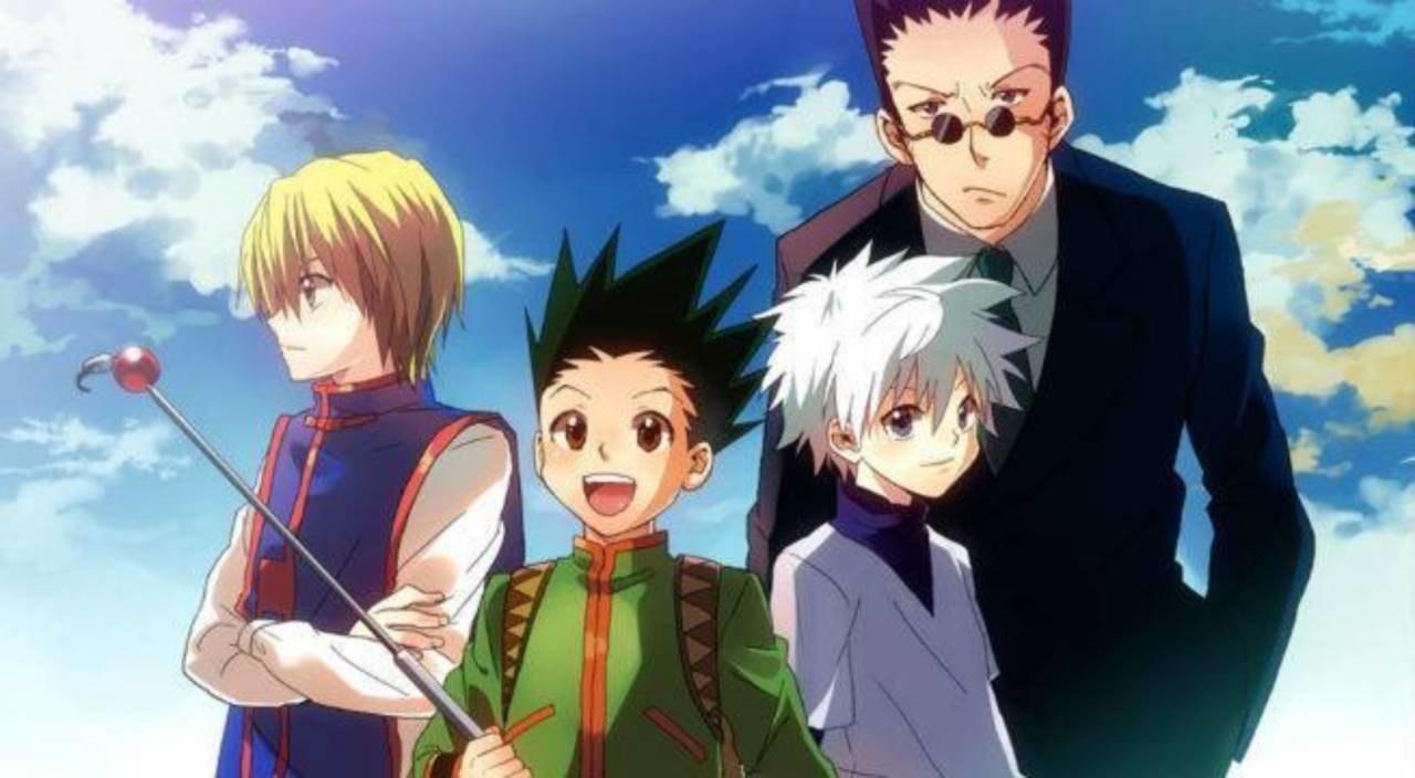 Gon standing and posing with Kurapika, Leorio and Killua