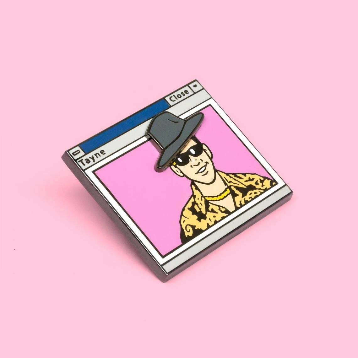 pin that looks like computer window with paul rudd in it wearing a flashy shirt, gold chain, sunglasses, and another layer that's a hat that moves