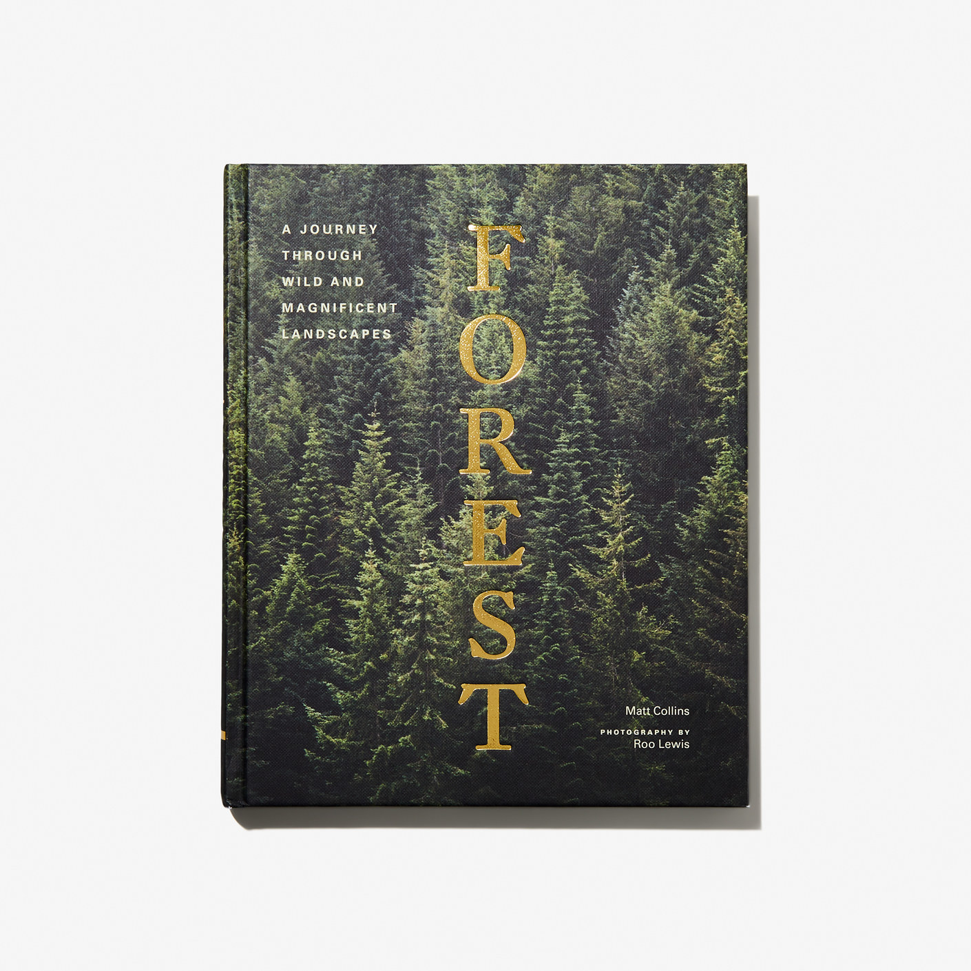 hardcover book with trees on it and the title forest in gold foil