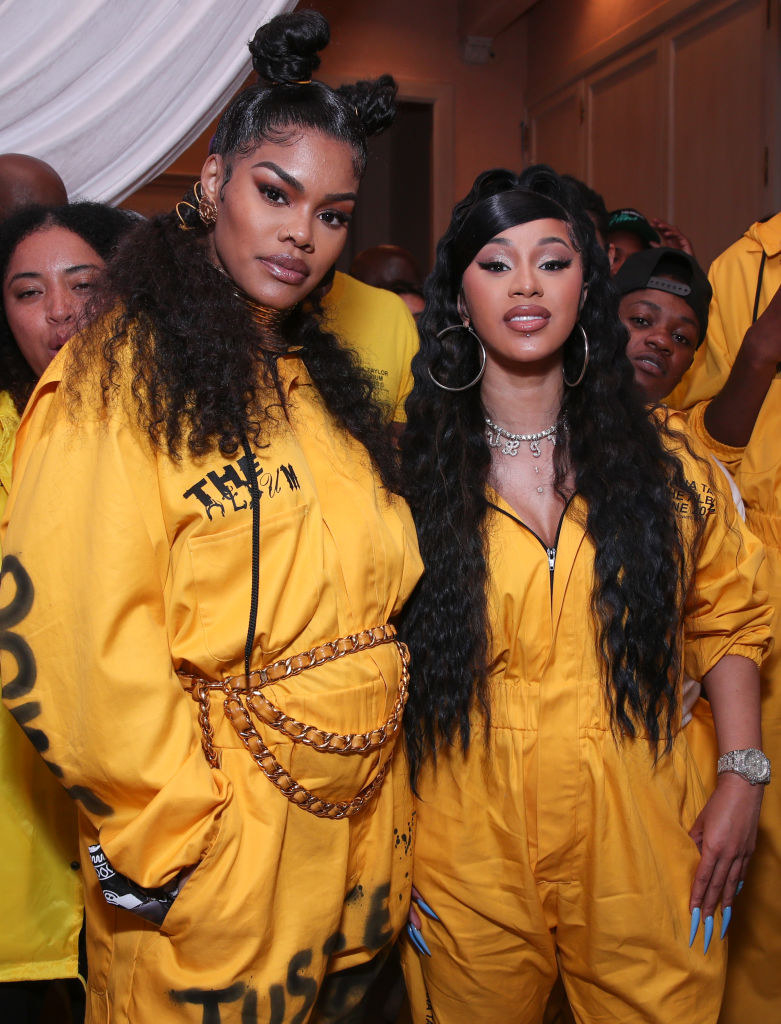 Teyana and Cardi B standing together
