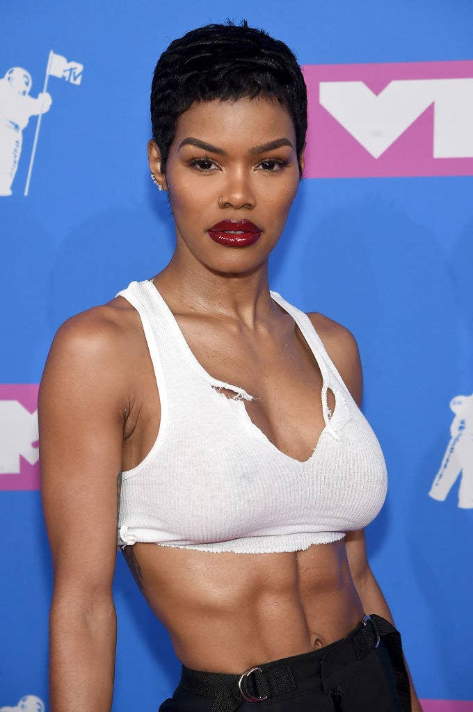 Teyana in a bright lipstick and crop top
