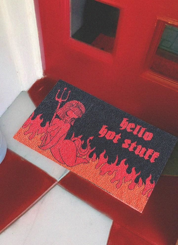 black doormat with fire and devil that says hello hot stuff