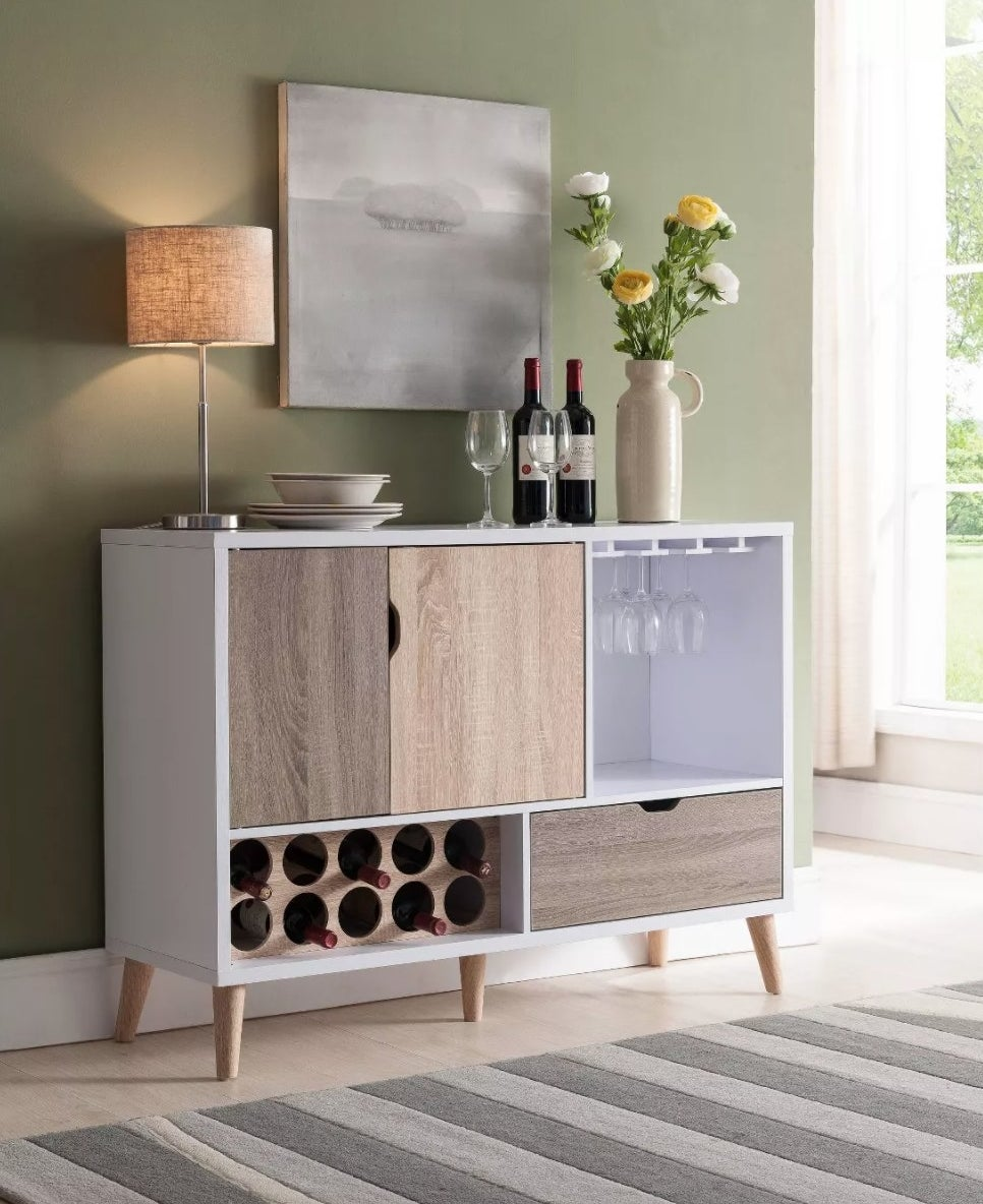 A buffet with storage cabinets, drawers, wine bottles and glass storage.