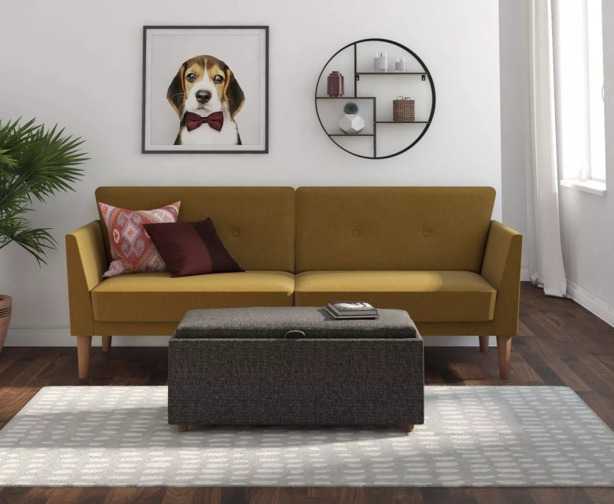 A mustard yellow sofa with wooden legs
