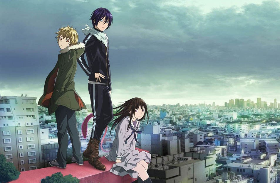 Yato, Hiyori and Yukin standing on a platform; you can see the cityscape behind them