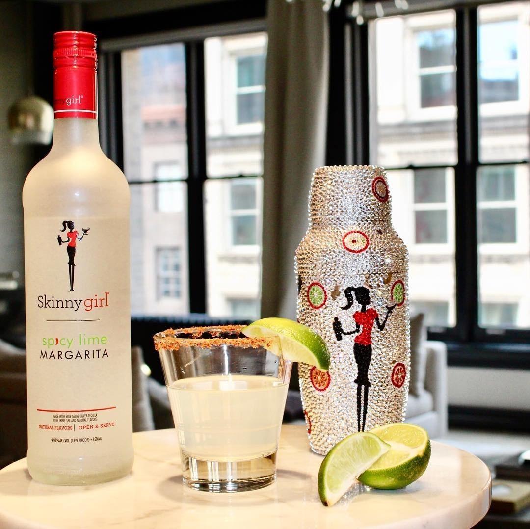 a bottle of skinnygirl spicy lime margarita and a bedazzled shaker
