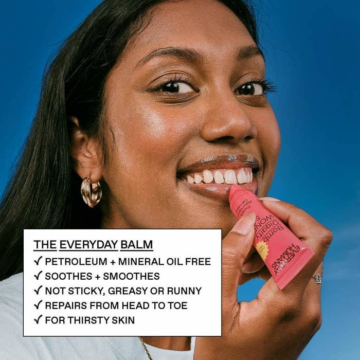 person putting the balm on their lips