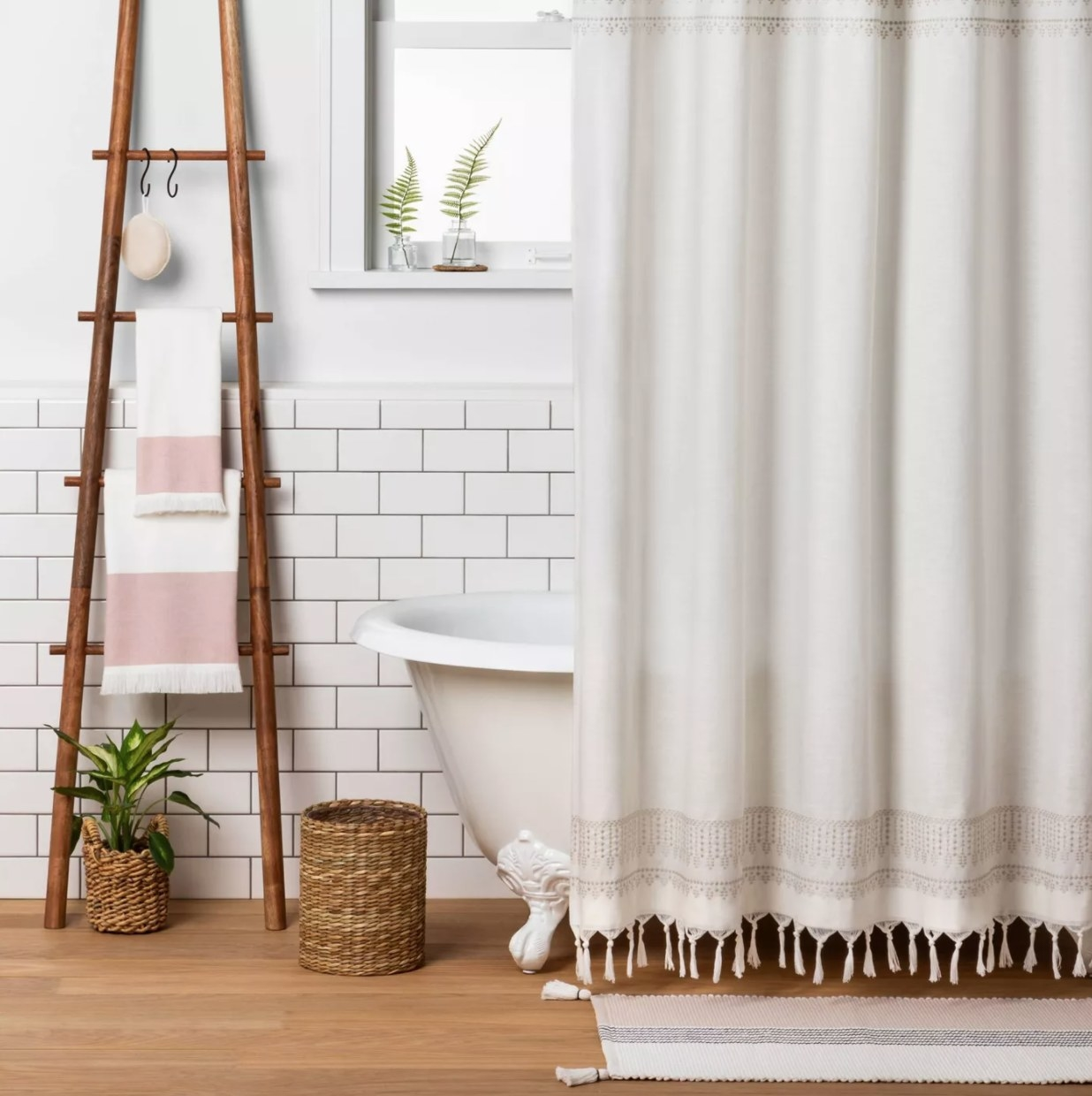A wooden decorative ladder leaning against a wall