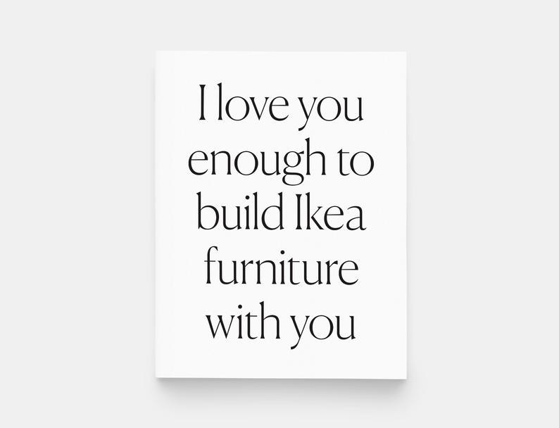 """The card, which is black type on plain white card stock, and reads """"I Love you enough to build Ikea furniture with you"""""""