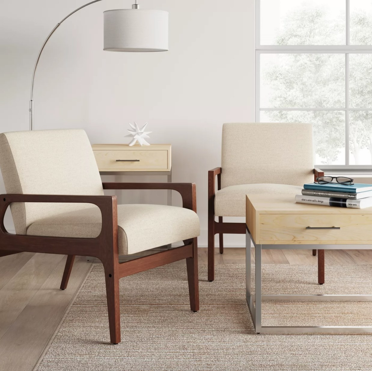 A cream-colored accent chair with wooden frame