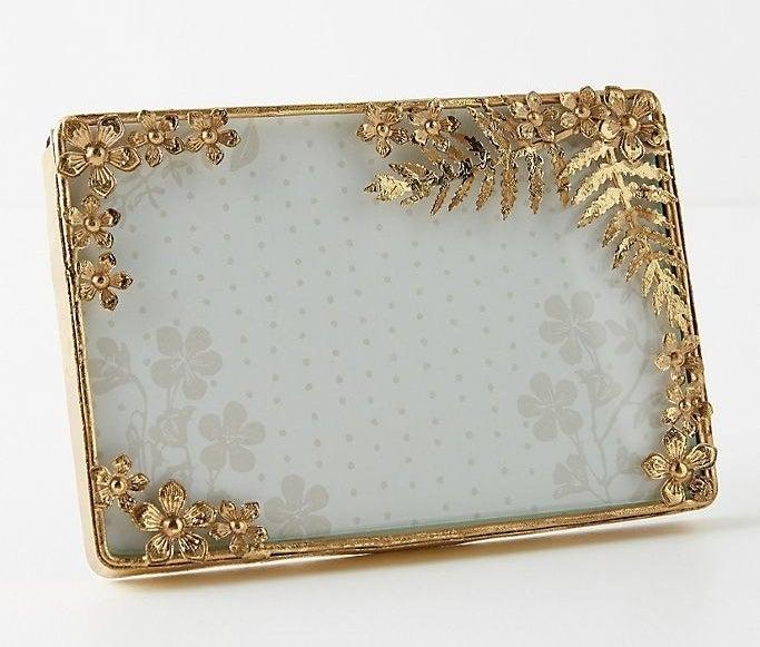 A gold flora and fauna frame