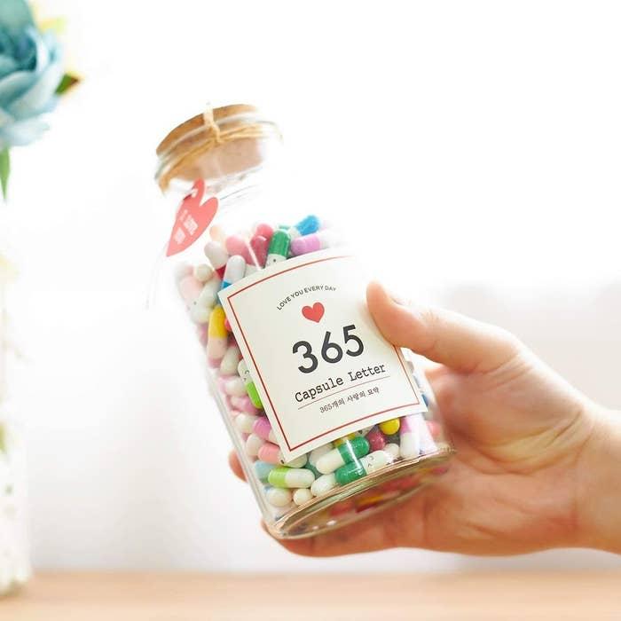 A jar of 365 Capsule Letters
