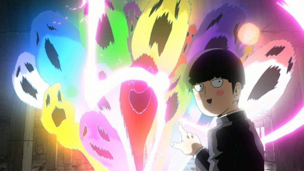 """Shigeo """"Mob"""" Kageyama pointing to colourful, sprit-like apparitions"""