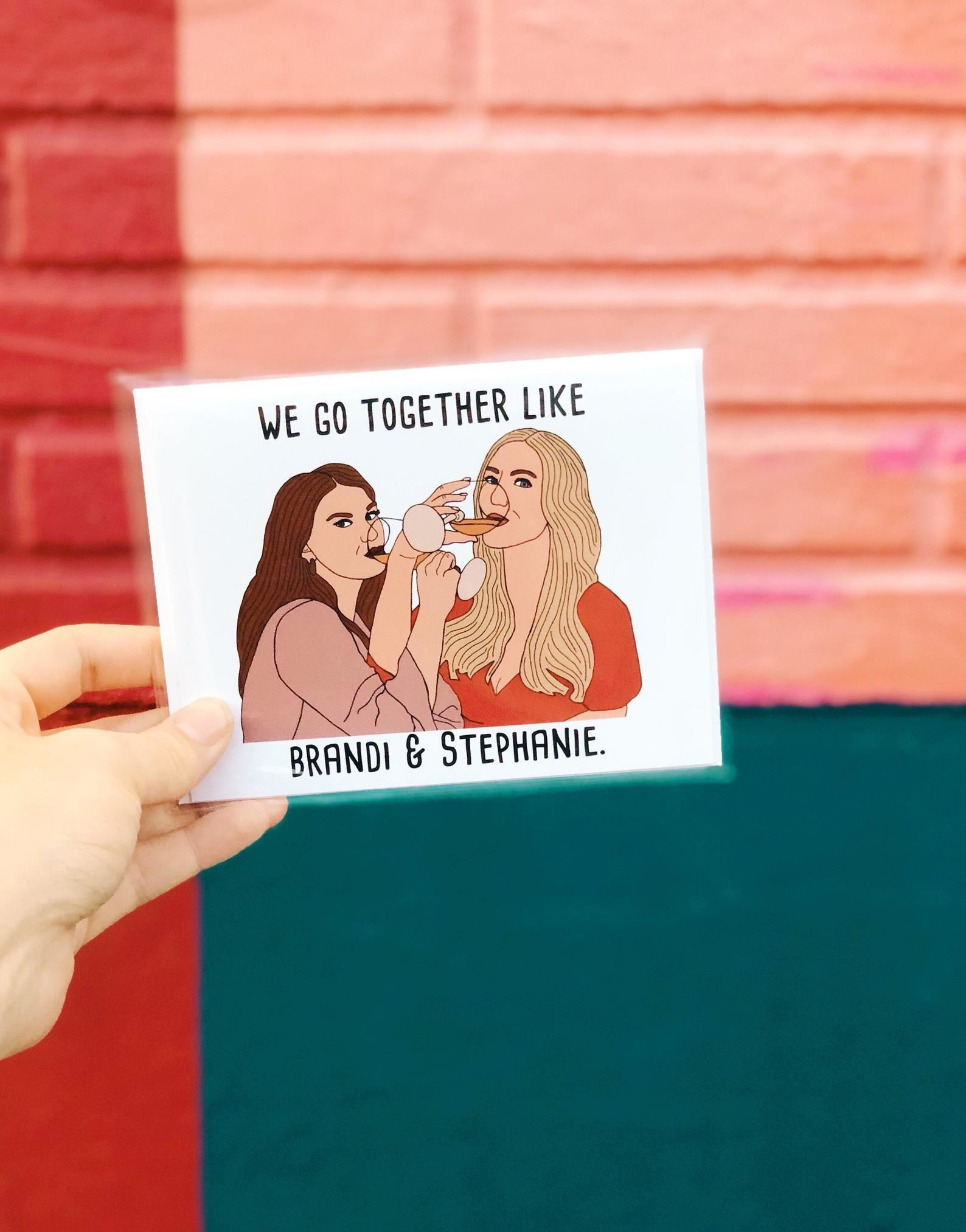 the card showing brandi and stephanie drinking wine together