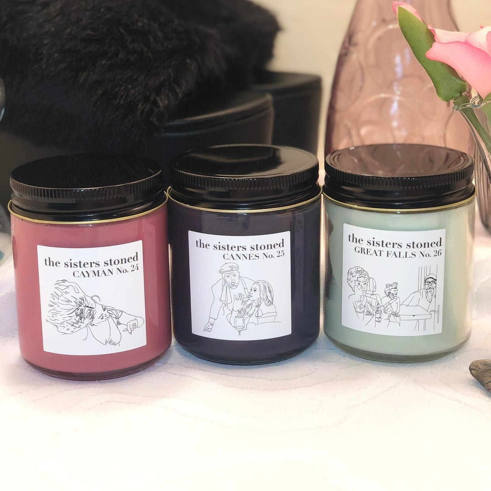 three candles with illustrations of real housewives of potomac moments on then