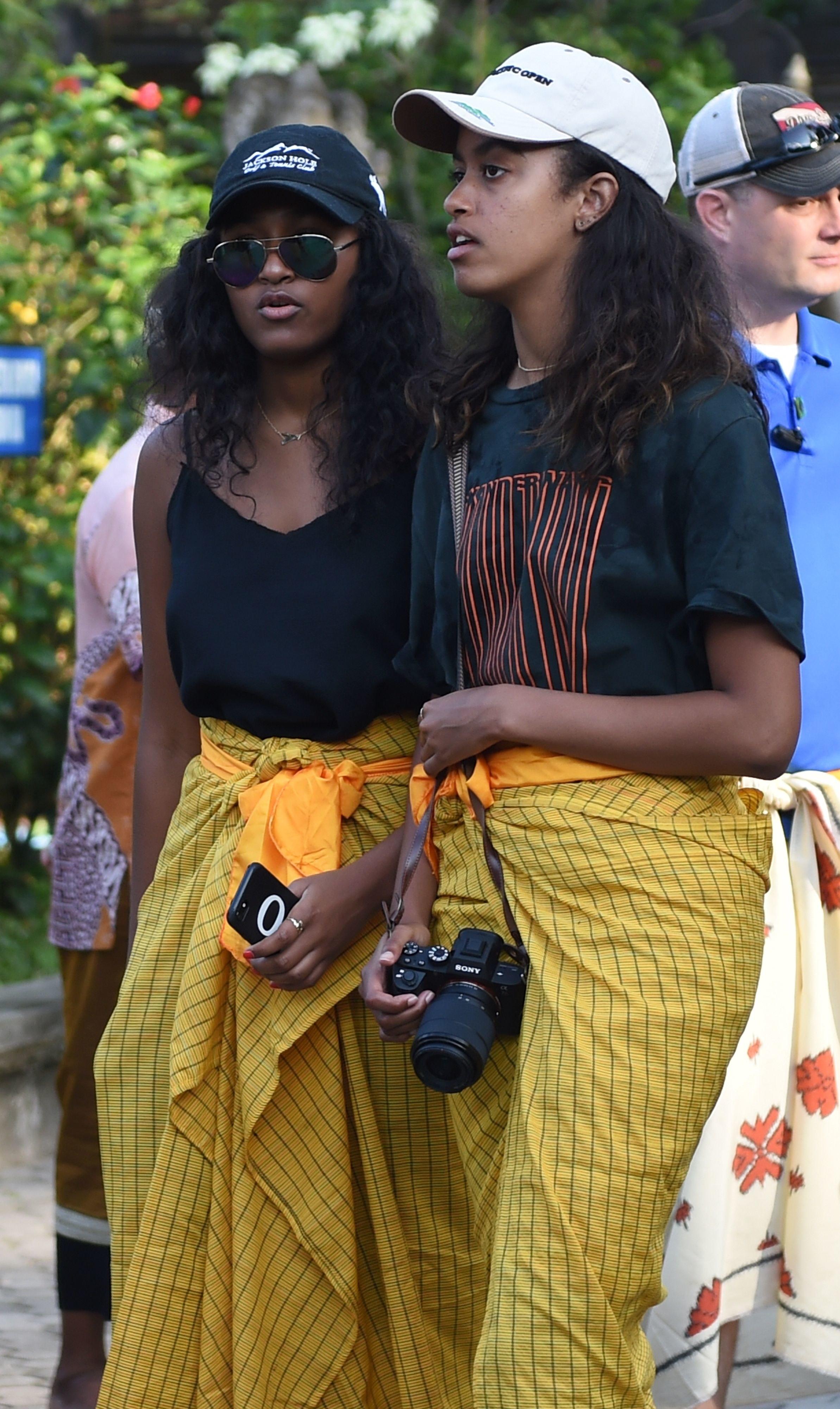 Sasha (L) and Malia (R), daughters of former US president Barack Obama, visit Tirtha Empul temple at Tampaksiring Village in Gianyar on the Indonesian resort island of Bali on June 27, 2017