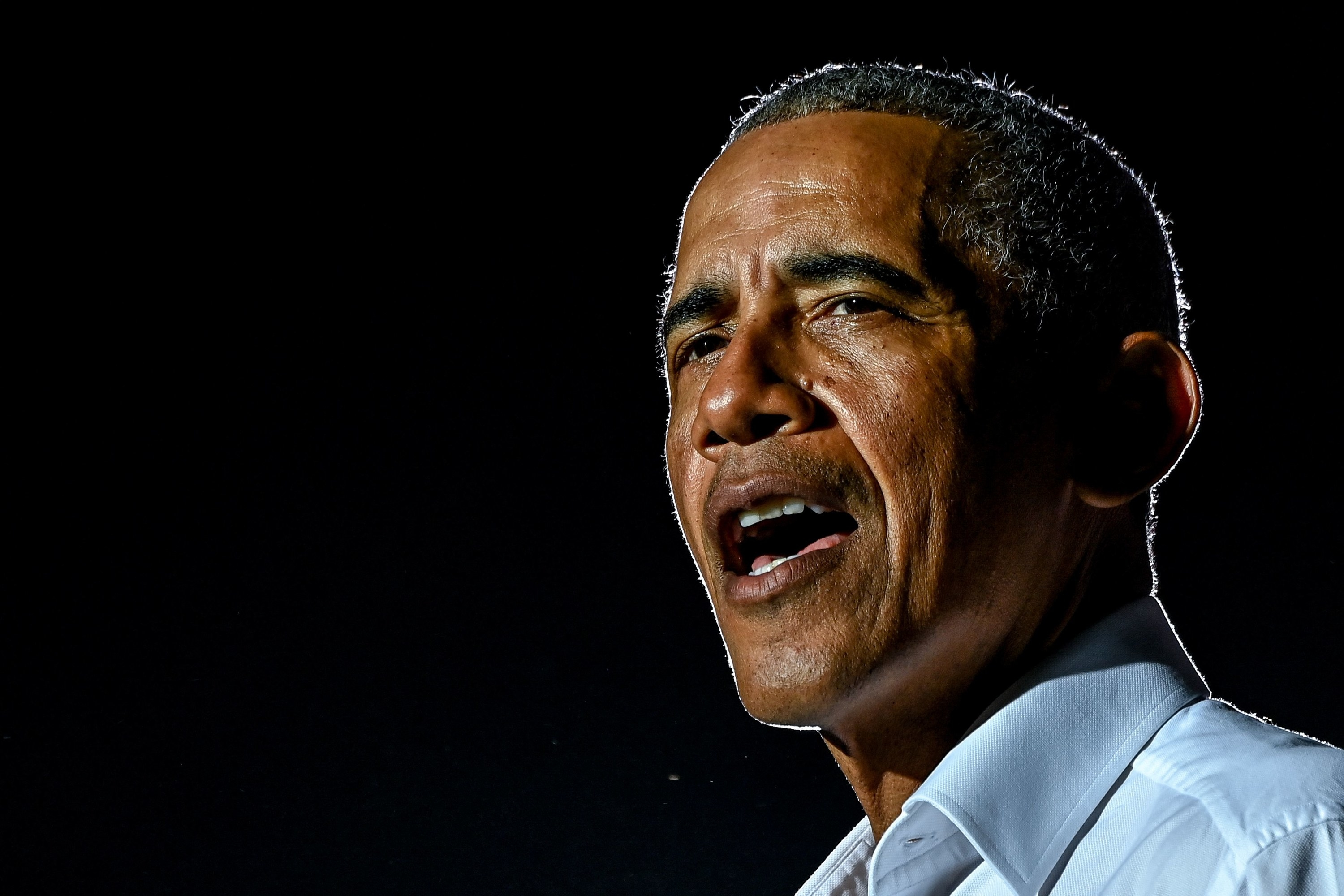 Former US President Barack Obama speaks at a drive-in rally as he campaigns for Democratic presidential candidate former Vice President Joe Biden in Miami, Florida on November 2, 2020
