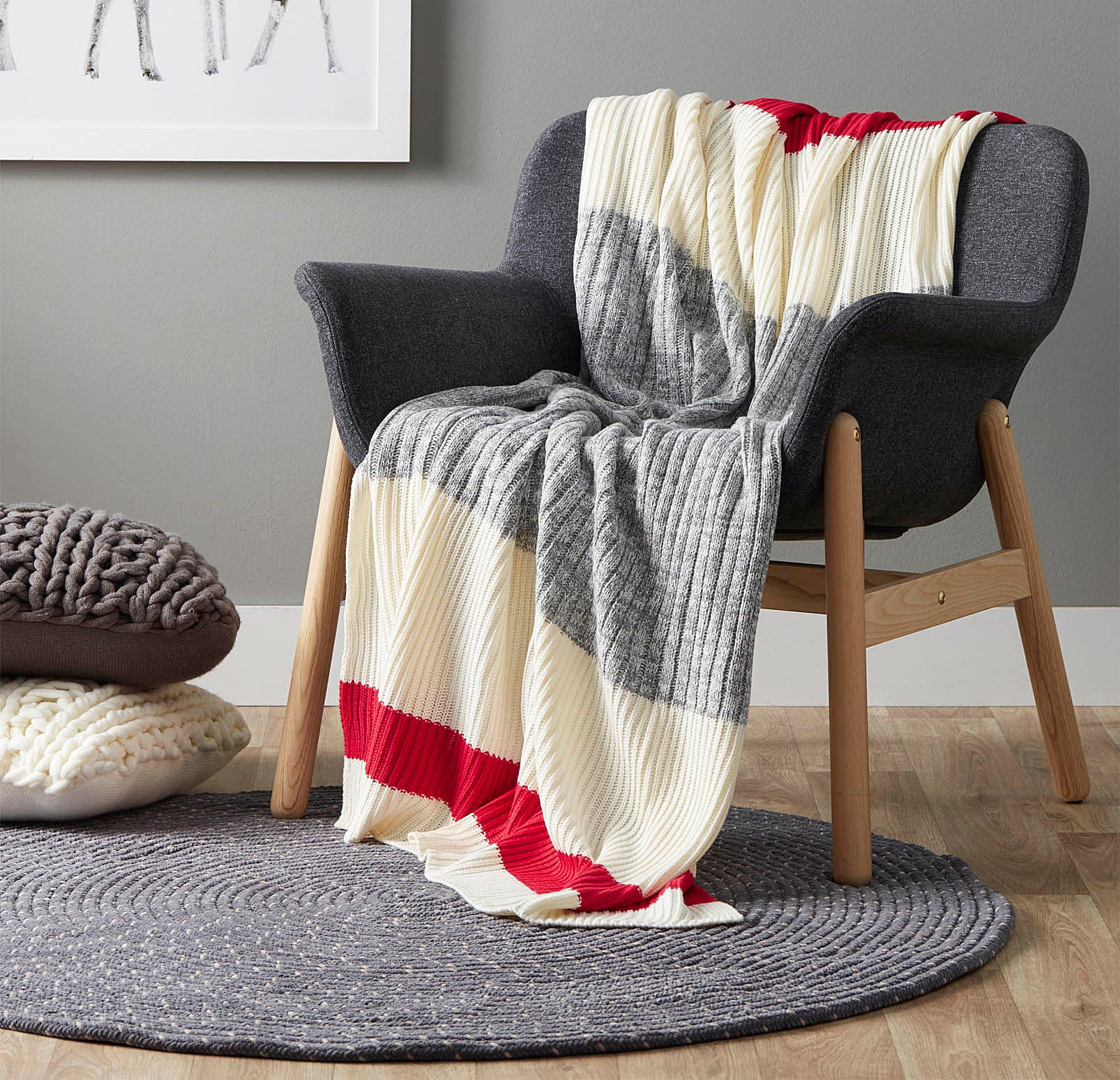 A knit blanket draped over a wooden chair