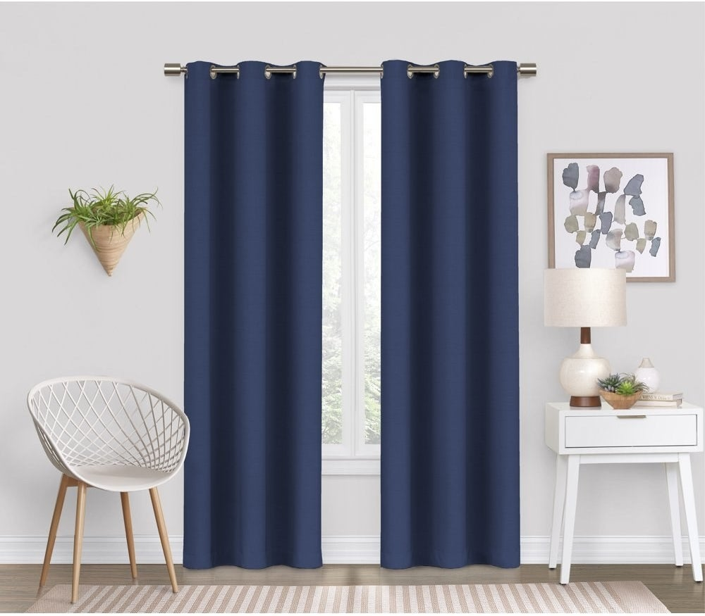 a pair of navy blue blackout curtains in a living room