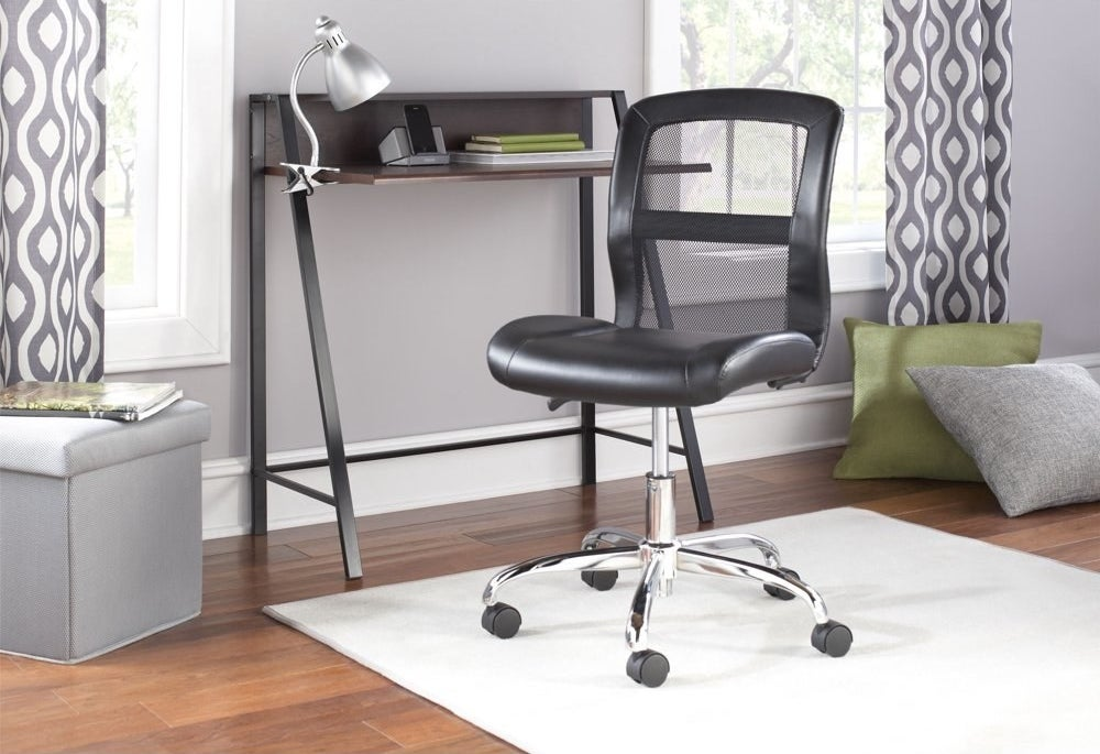 a black mesh office chair with silver legs and black wheels