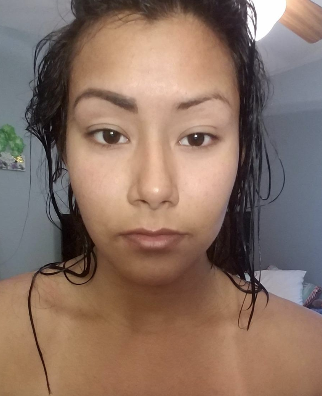 reviewer using the tinted brow gel