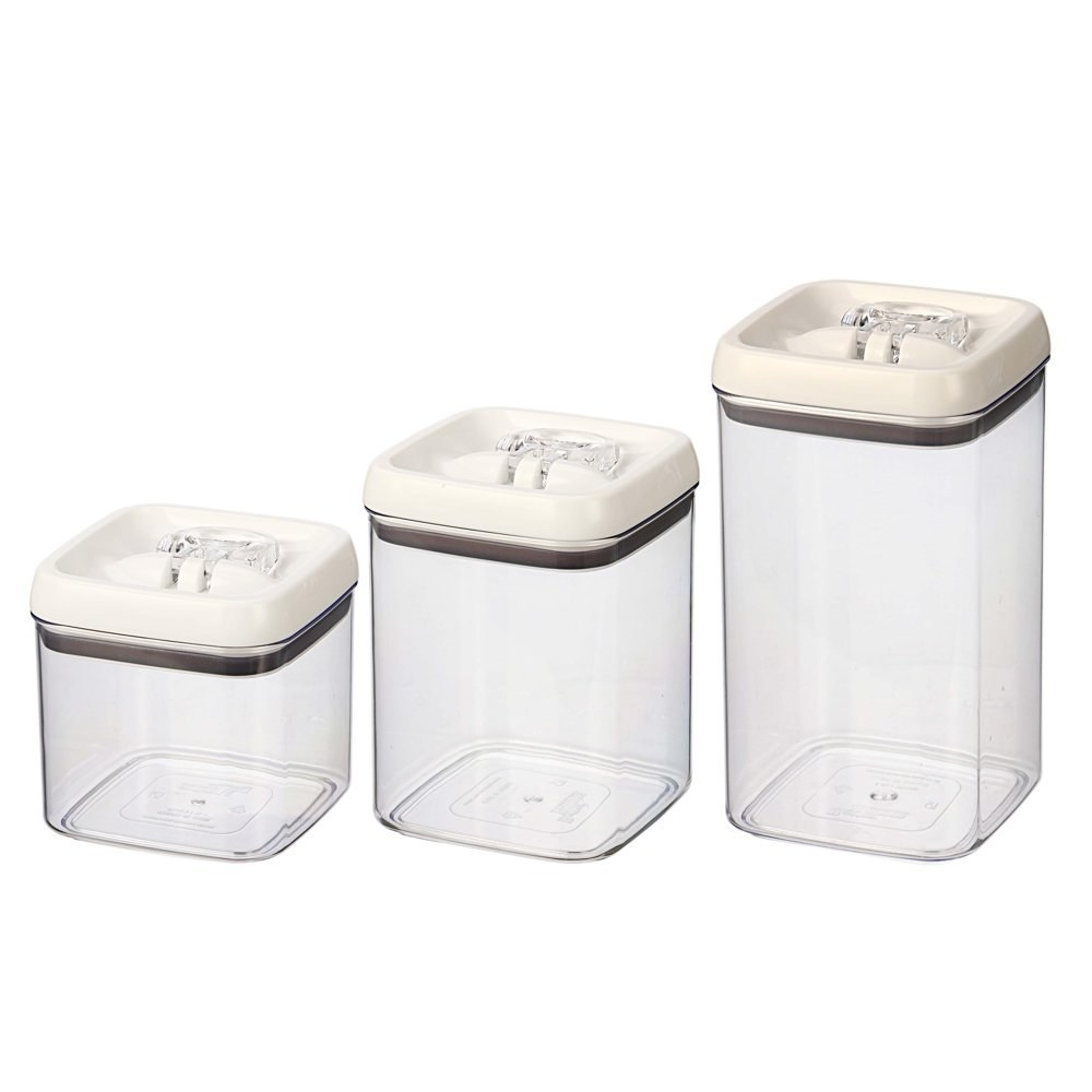 three airtight containers of various sizes with white lids