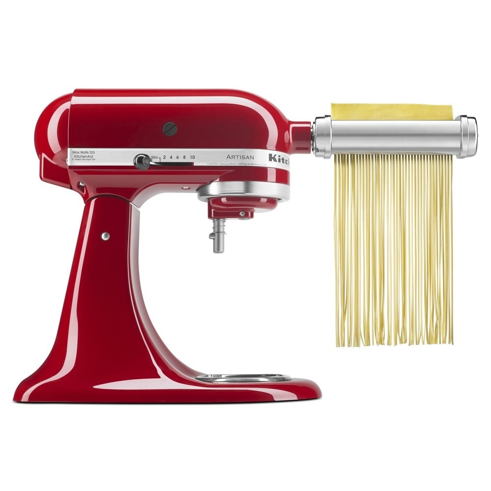 a pasta making attachment attached to a red KitchenAid stand mixer