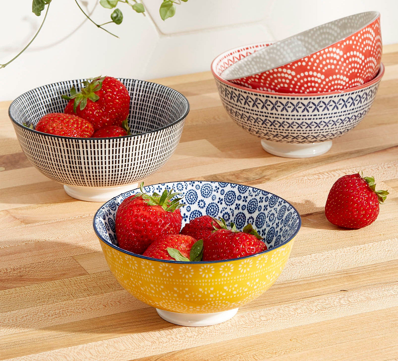 Four fun and fresh patterned bowls with strawberries