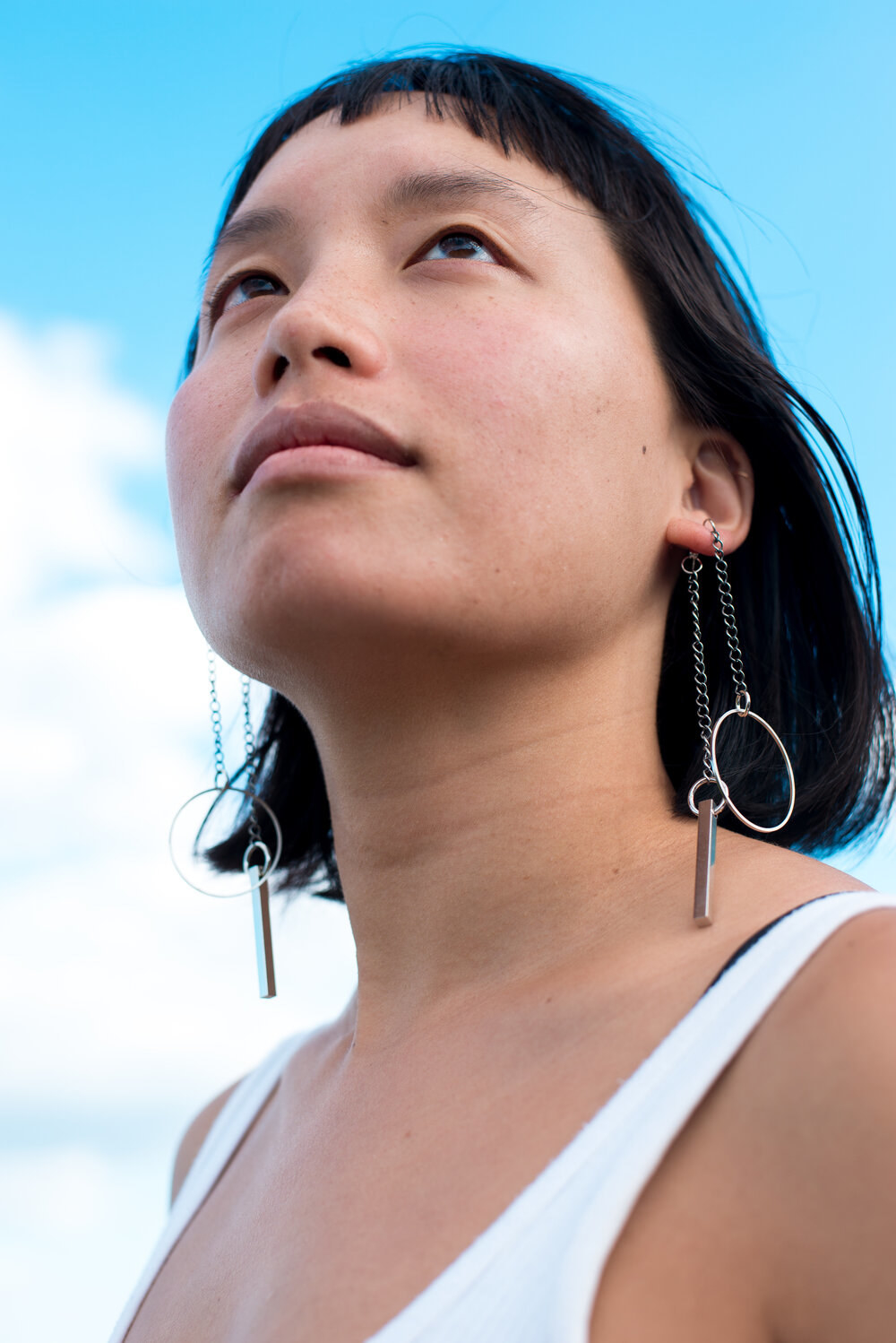 a model wearing the earrings