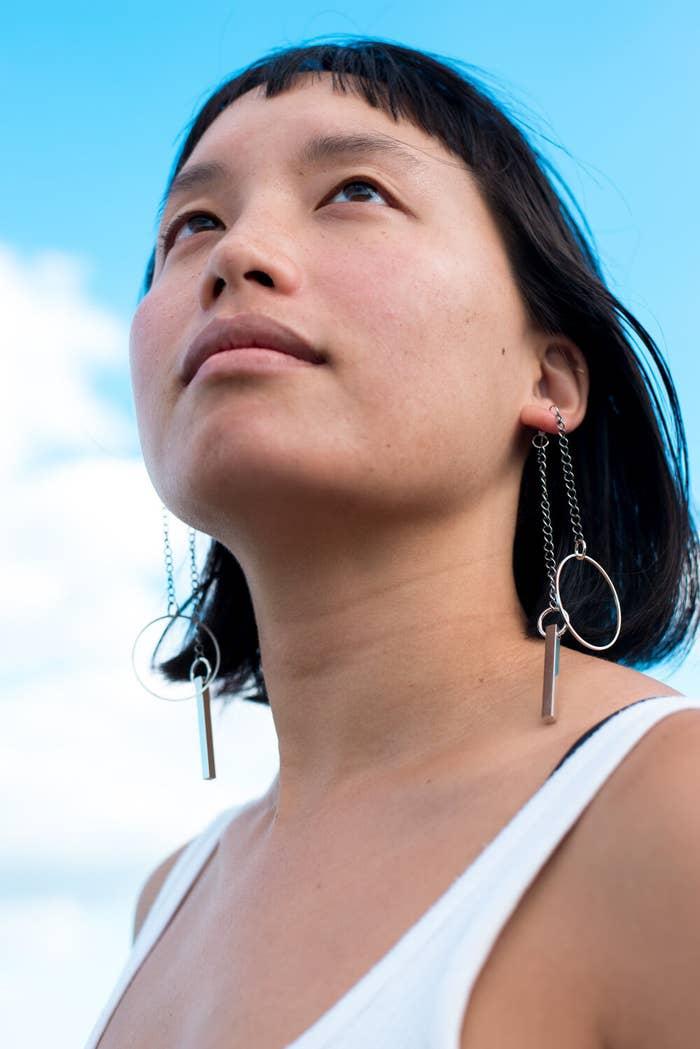a model wearing the earrings