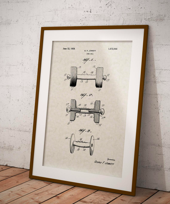 A framed patent print for dumbbells on a wooden floor